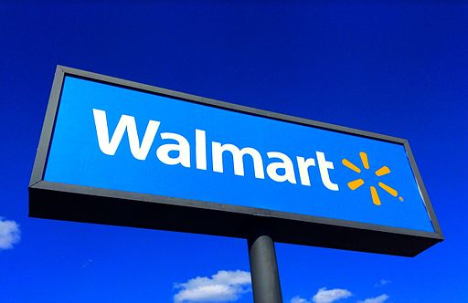 Walmart sign with blue sky background.