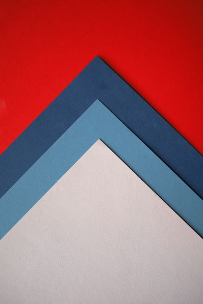 red, dark blue, light blue and white paper turned so that corners pointing up like arrow