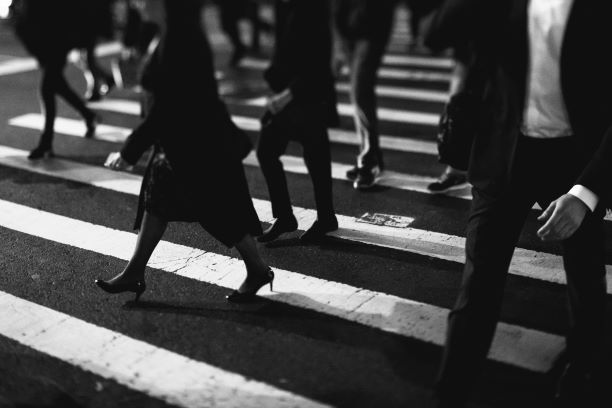 Business people walking in crosswalk (black and white photo)