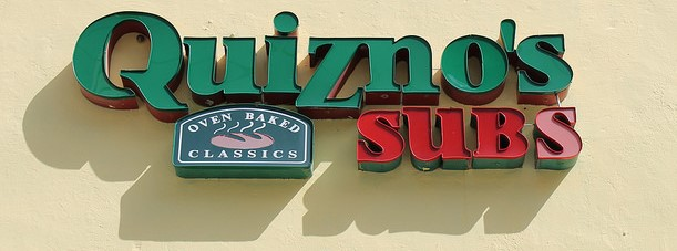 Quiznos sign on side of building