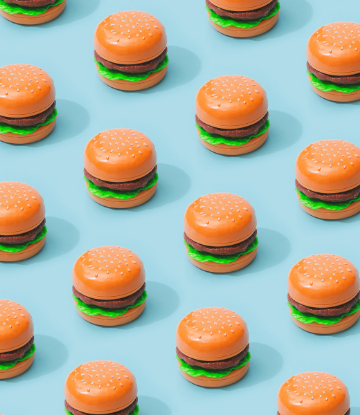 Supply Chain Scene, image of a group of miniature, plastic burgers