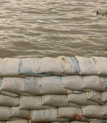 Supply Chain Scene, image of sand bags holding back water