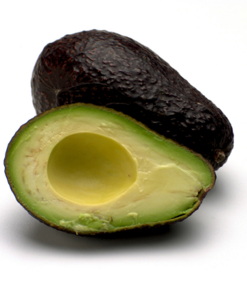 Supply Chain Scene, image of a cut open avocado on its side