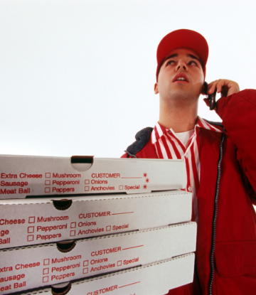 Supply Chain Scene, image of delivery man with stack of pizza boxes