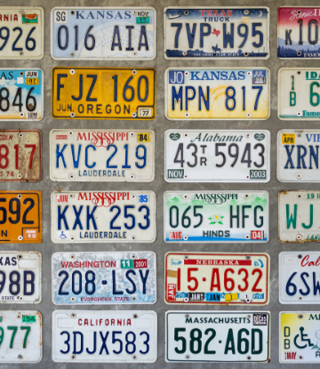 Supply Chain Scene, image of a wall of license plates from many states
