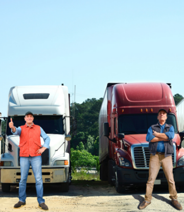 Supply Chain Scene, image of two drivers standing in front of large trucks