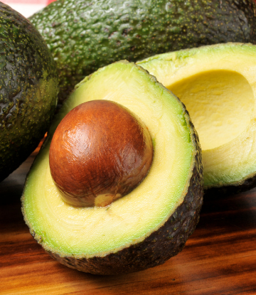 Supply Chain Scene, image of a fresh avocado sliced in half