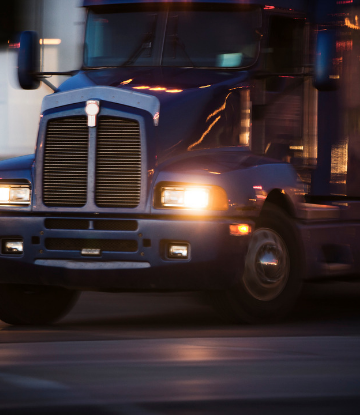 Supply Chain Scene, image of the front of an 18 wheeler truck at night