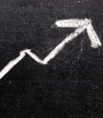 Supply Chain Scene, image of a chalk drawn arrow, pointing upward