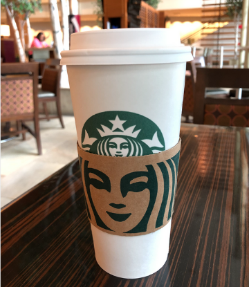 Supply Chain Scene, image of a Starbucks cup on a table