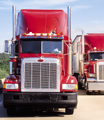 Supply Chain Scene, image of two large trucks