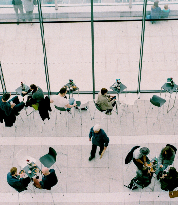 Supply Chain Scene, overhead image of business people in small groups, next to large office windows