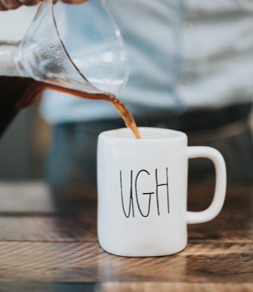 "Supply Chain Scene, image of man pouring coffee in to a cup that reads ""UGH""."