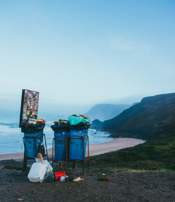 Supply Chain Scene, image of blue trash bins next to the beach