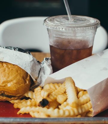 Supply Chain Scene, image of burger, fries, drink as takeout meal