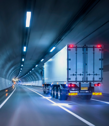 SCS, image of a large semi truck driving through a road tunnel