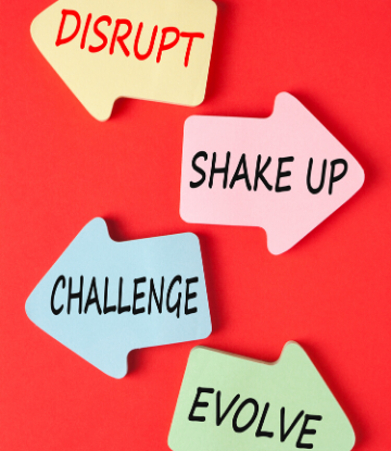 SCS, image of the words disrupt, shake up, challenge, and evolve on a red board