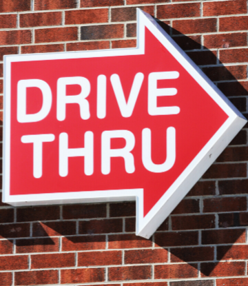 SCS, image of an arrow shaped sign that reads DRIVE THRU