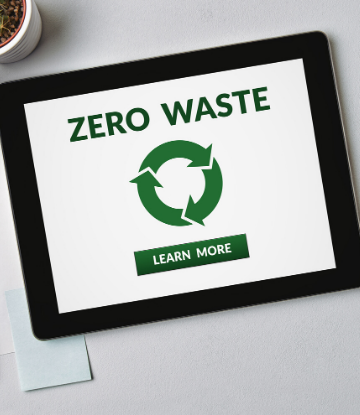 SCS, imge of an ipad with the words ZERO WASTE on it in green with the symbol for recycling